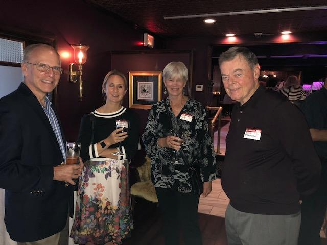 Four attendees at networking